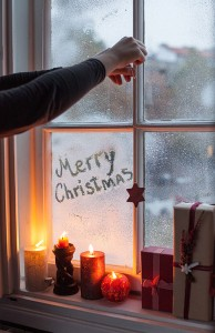 Lighting christmas candles next to the window