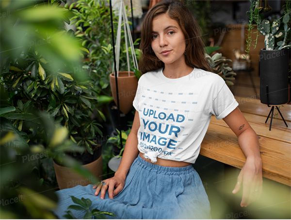 t-shirt mockup of a woman relaxing in her garden