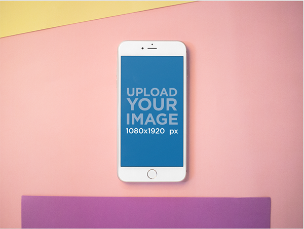 Mockup of an iphone lying on a pink surface with purple and yellow